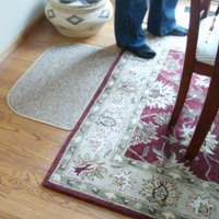 Dining room area rug under table