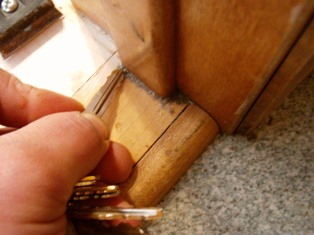 Grimy corners of wood floor