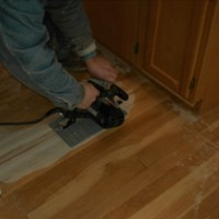 Floorwright cutting into wood floor for repair