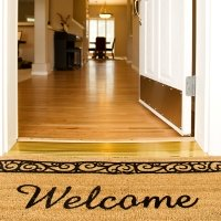 Welcome mat by open front door