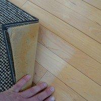 wood floor discolored under rug
